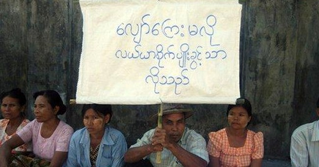 Myanmar police charge 7 for staging land protest