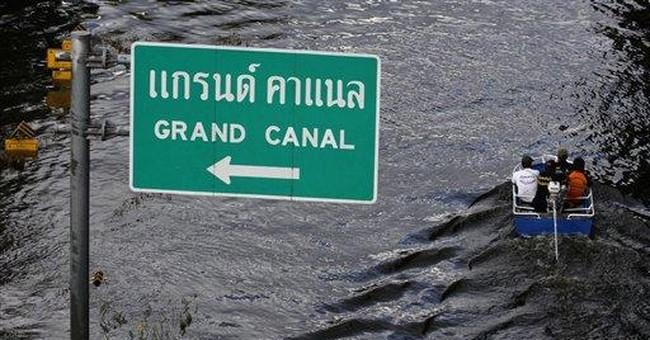 Riverfront flooding widens, but Bangkok mostly dry