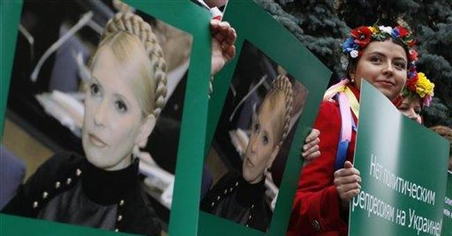 Ukraine investigating ex-PM in murder case