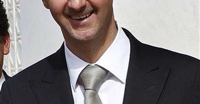 Syria's Assad warns West against intervention