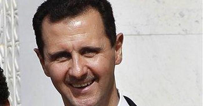 Syria's Assad warns West against intervention