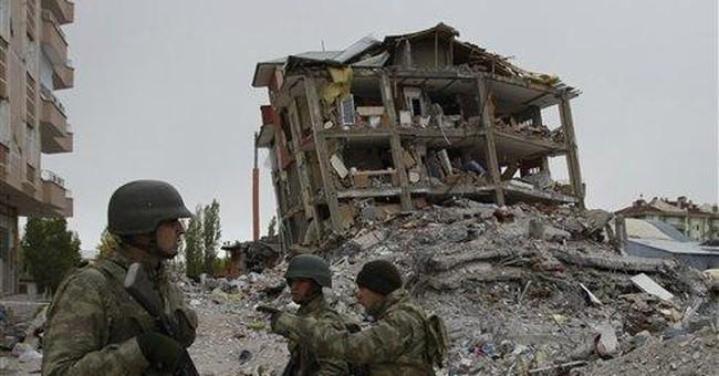 Turkish workers clear debris in quake zone