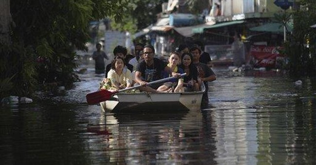 Tempers flare on front lines of Thailand's floods