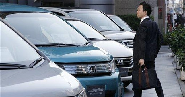 Honda's profit sinks, Thai flooding clouds outlook