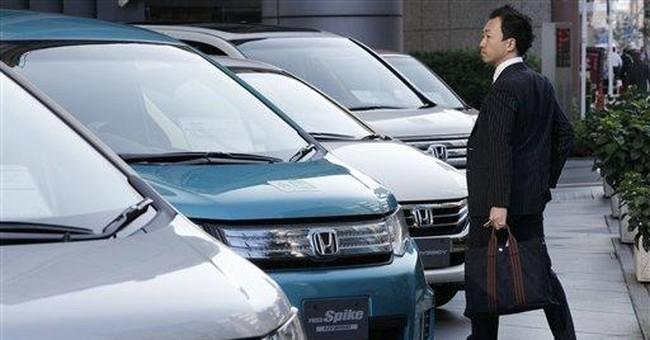 Honda's profit sinks, Thai flooding clouds outlook