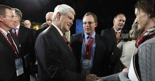 GOP group minus leaders Romney, Cain talk economy