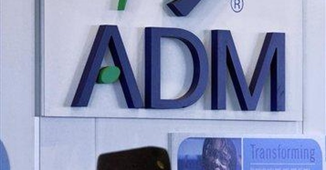 ADM earns up on accounting gain, adj profit falls