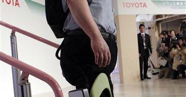 Toyota shows machines to help sick, elderly move