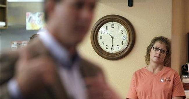 Santorum campaigns for surprise finish in caucuses