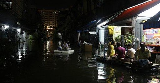 Thai flood holdouts complicate relief efforts