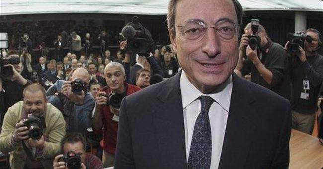 ECB cuts key rate at 1st Draghi meeting