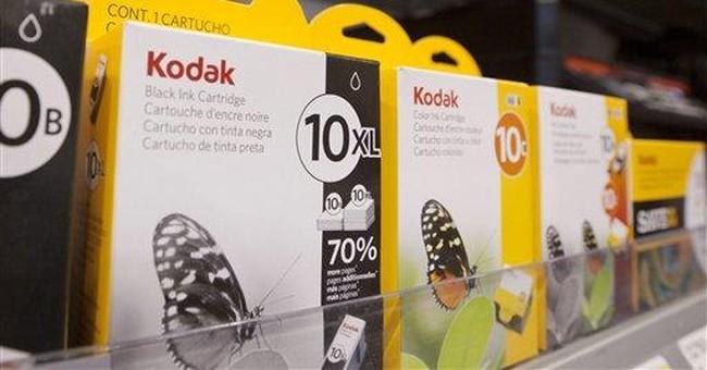 Kodak posts wider loss, warns on prospects