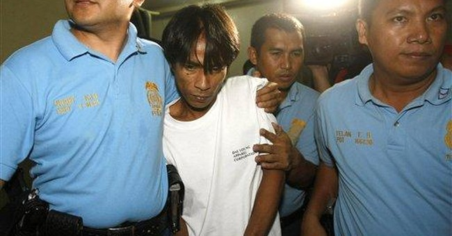 Suspect in killing of Charice's father surrenders