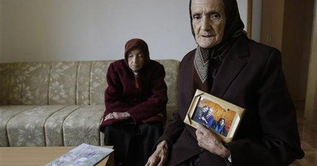 Refugees in Bosnia get homes after Jolie's visit