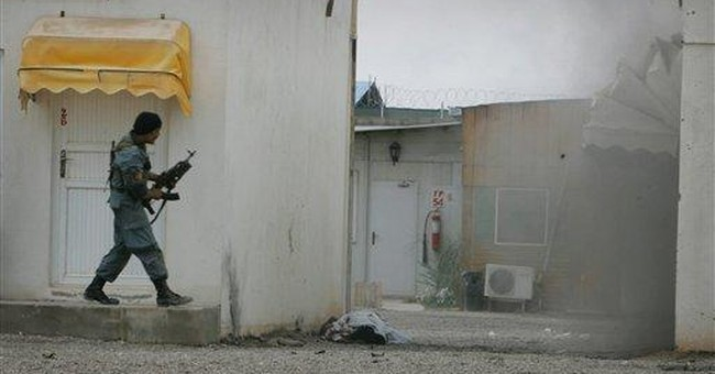 Suicide bombers, insurgents attack NATO contractor