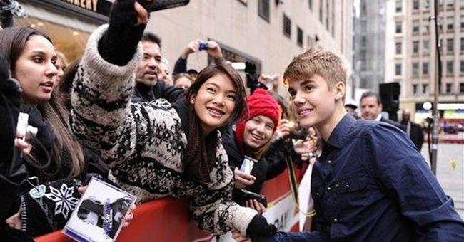 Woman suing Bieber faces Vegas battery trial