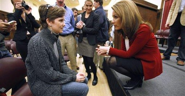 Bachmann reticent to talk about Cain controversy