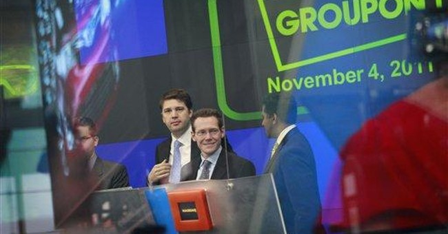 Groupon sizzles in public debut but worries linger