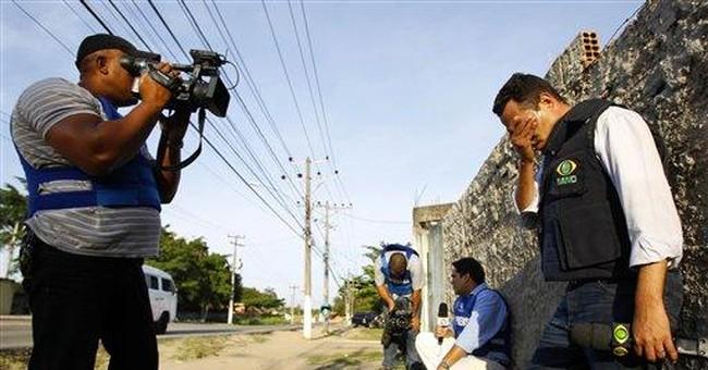 Cameraman killed in police operation in Rio slum