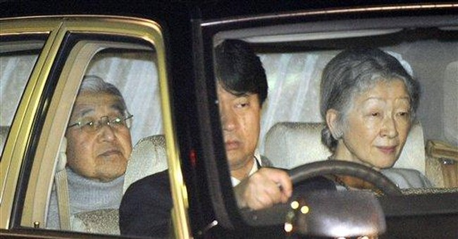 Japan's emperor hospitalized with fever, cold