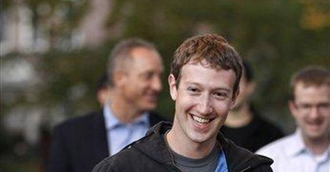 Facebook founder returns to Harvard to recruit
