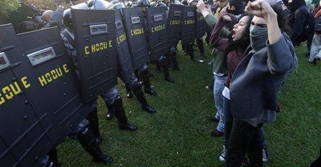 Brazil police forcibly remove protesting students