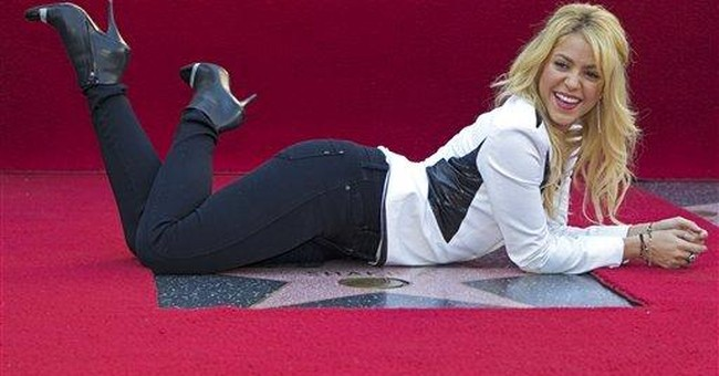 Shakira enshrined with Hollywood sidewalk star