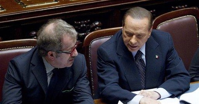 Italy's Berlusconi to resign after reforms pass