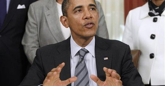 Obama signs order to cut travel, cellphones, swag