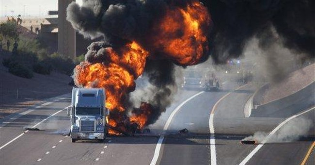 2 tankers collide, burn in Phoenix; trucker killed