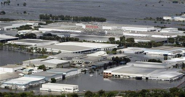 Recovering Japan automakers now fight Thai floods