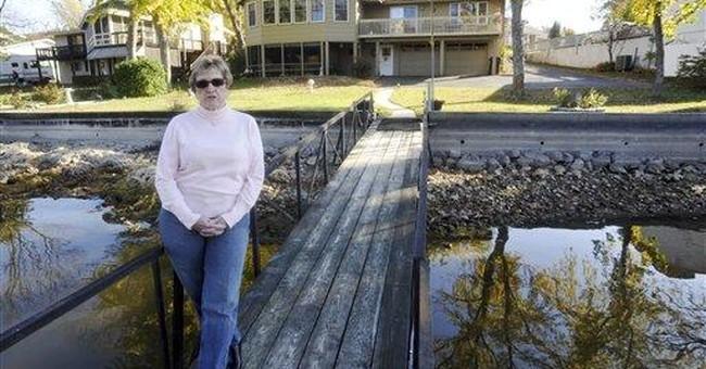 Regulators revise order for buildings at Mo. lake