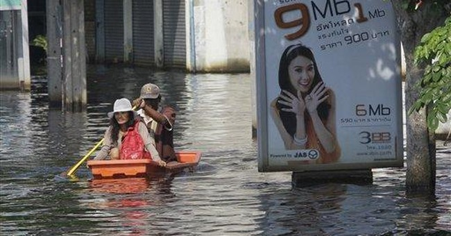 Thailand tries to help companies as floods spread