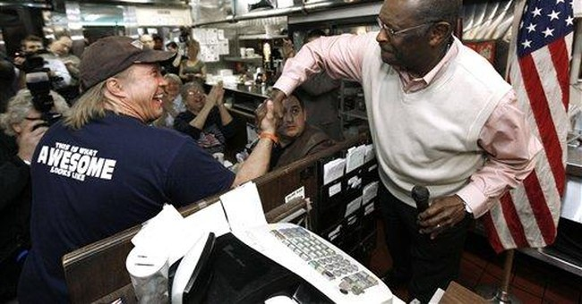 Cain gets back to campaigning amid scandal