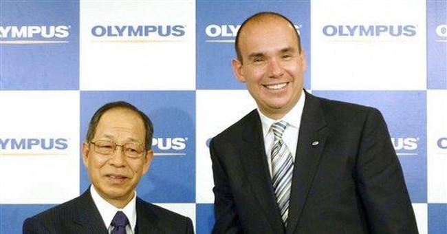Japan financial chief confirms Olympus probe