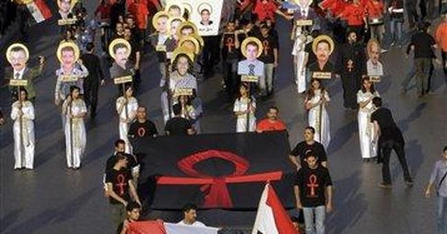 Hundreds march in Egypt to mourn slain Christians