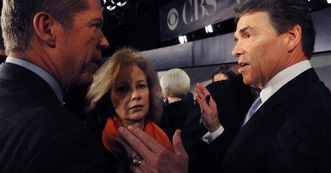 SPIN METER: Perry decries, chases gov't spending