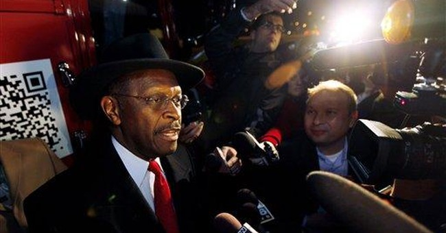 Cain stumbles talking about intervention in Libya