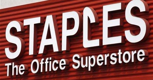Staples 3Q profit rises, lowers 2011 outlook