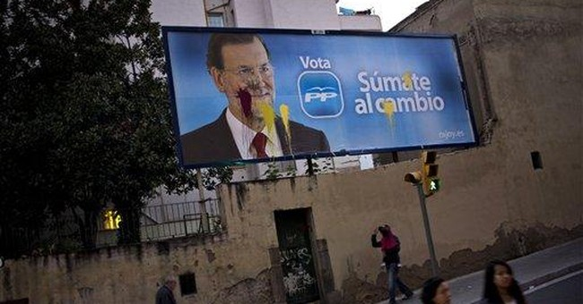 Job-hungry Spaniards seen electing center-right