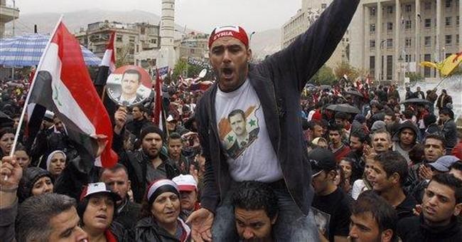 Syrian troops attack despite Arab peace plan