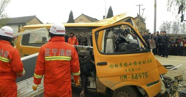 Overpacked China school bus crashes, 18 kids die