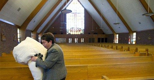 Boston Catholic holdouts say archdiocese moving in