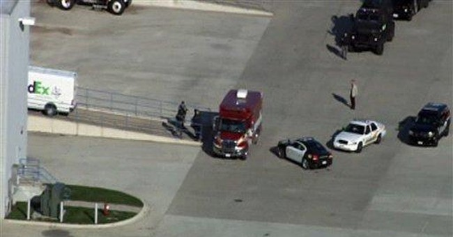 Gunman fatally shoots himself at Ill. FedEx center