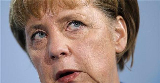 Merkel, Cameron meet amid tension over crisis