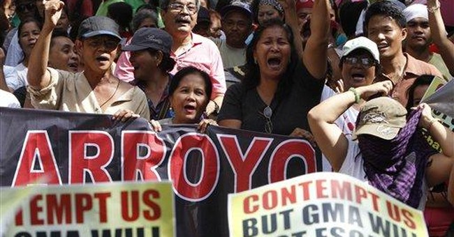 Philippines arrests ex-president in hospital room