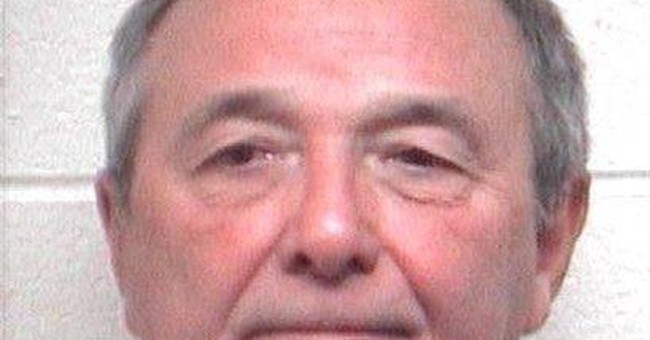 Former ADP CEO faces domestic violence charge