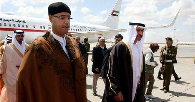 Libya says Gadhafi son to be tried at home