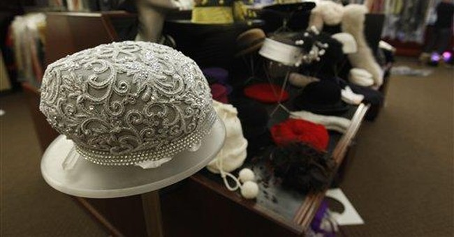 Buyers at sale target hats worn by Queen of Soul