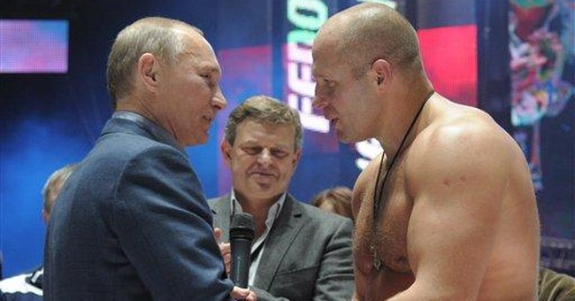 Moscow martial arts fans greet Putin with catcalls